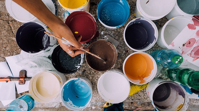 Buckets of paint with hand